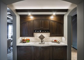 Gilmans Kitchens and Baths Dark Brown Kitchen Cabinets and Light Countertop