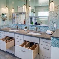 Dura Supreme Light Bathroom Cabinets and Dark Countertop